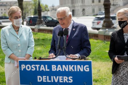 United States Representative Bill Pascrell (Democrat of New Jersey), center, is joined by United States Representative Marcy Kaptur (Democrat of Ohio), left, and United States Senator Kirsten Gillibrand (Democrat of New York), right, as he offers remarks during a press conference on postal banking pilot programs on the East Front of the US Capitol in Washington, DC,.