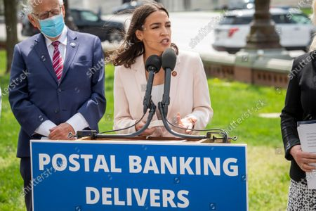 United States Representative Alexandria Ocasio-Cortez (Democrat of New York) offers remarks during a press conference on postal banking pilot programs on the East Front of the US Capitol in Washington, DC,.