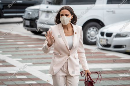 United States Representative Alexandria Ocasio-Cortez (Democrat of New York) arrives for a press conference on postal banking pilot programs on the East Front of the US Capitol in Washington, DC,.