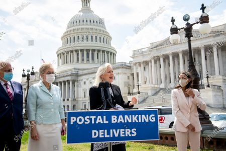 United States Senator Kirsten Gillibrand (Democrat of New York), center, is joined by United States Representative Bill Pascrell (Democrat of New Jersey), left, United States Representative Marcy Kaptur (Democrat of Ohio), second from left, and United States Representative Alexandria Ocasio-Cortez (Democrat of New York), right, offers remarks during a press conference on postal banking pilot programs on the East Front of the US Capitol in Washington, DC,.