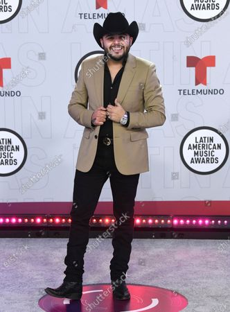 Gerardo Ortiz arrives at the Latin American Music Awards at the BB&T Center, in Sunrise, Fla