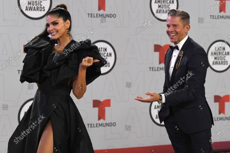 Ana Barbara, left, and Rodner Figueroa arrive at the Latin American Music Awards at the BB&T Center, in Sunrise, Fla