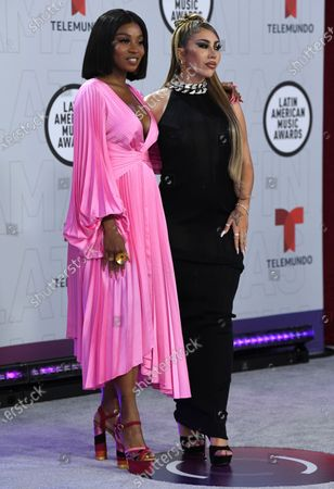 Goyo, left, and Kali Uchis arrive at the Latin American Music Awards at the BB&T Center, in Sunrise, Fla