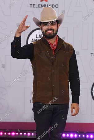 Joss Favela arrives at the Latin American Music Awards at the BB&T Center, in Sunrise, Fla