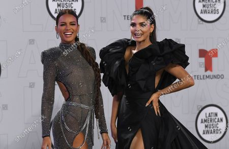 Zuleyka Rivera, left, and Ana Barbara arrive at the Latin American Music Awards at the BB&T Center, in Sunrise, Fla