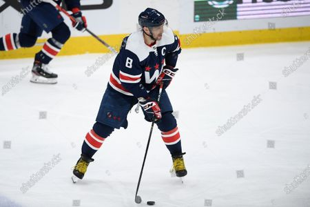 Washington Capitals left wing Alex Ovechkin (8) skates with the puck during the second period of an NHL hockey game against the Buffalo Sabres, in Washington