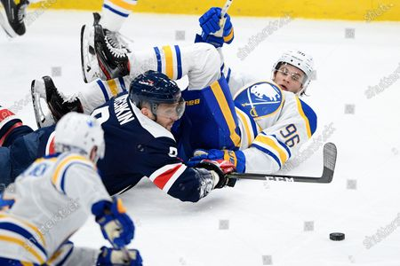 Stock Picture of Washington Capitals left wing Alex Ovechkin (8) and Buffalo Sabres left wing Anders Bjork (96) battle for the puck during the third period of an NHL hockey game, in Washington. The Sabres won 5-2