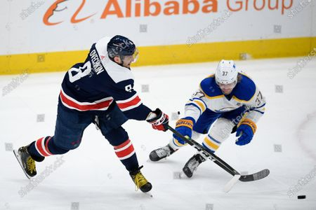 Washington Capitals left wing Alex Ovechkin (8) shoots the puck past Buffalo Sabres center Casey Mittelstadt (37) during the second period of an NHL hockey game, in Washington