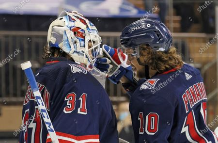 Stock Image of New York Rangers' Igor Shesterkin (31) and Artemi Panarin (10) celebrate their shutout against the New Jersey Devils in an NHL hockey game, in New York