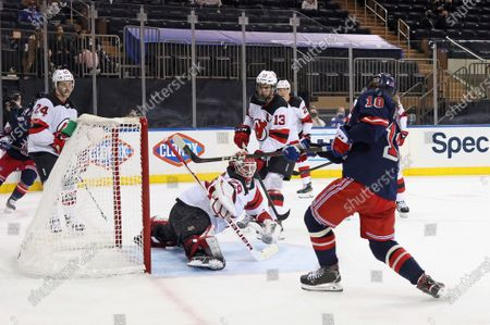 Stock Photo of New York Rangers' Artemi Panarin (10) scores in the second period against New Jersey Devils' Mackenzie Blackwood (29) during an NHL hockey game, in New York