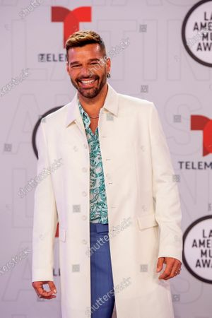 Puerto Rican singer Ricky Martin on the red carpet for the Sixth Annual Latin American Music Awards at the BB&T Center in Sunrise, Florida, USA, 15 April 2021. The Latin American Music Award nominations are based on fan interactions with music in areas of sales, streaming and airplay as tracked by Billboard for the period 17 January 2020 through 21 January 2021.