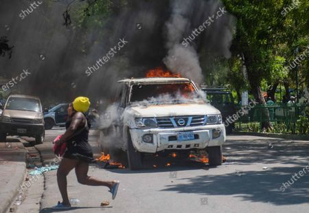 Protesters clash with police after a mass in the church of San Pedro at Petion-Ville, Port-au-Prince, Haiti, 15 April 2021. The bishops of Haiti celebrated a mass to protest against the abduction of twelve members of the clergy on 11 April. Since July 2018, Haiti has been mired in a strong protest movement demanding the resignation of President Jovenel Moise on allegations of not keeping his promises and profiting from corruption.