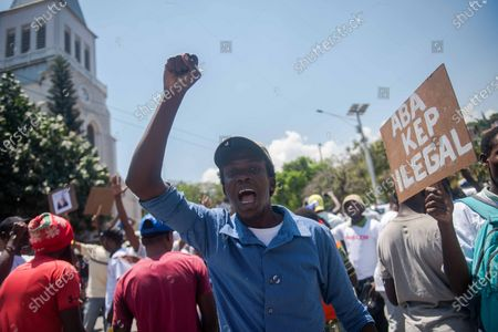 Protesters shout slogans during a rally following a mass held at the church of San Pedro at Petion-Ville, Port-au-Prince, Haiti, 15 April 2021. The bishops of Haiti celebrated a mass to protest against the abduction of twelve members of the clergy on 11 April. Since July 2018, Haiti has been mired in a strong protest movement demanding the resignation of President Jovenel Moise on allegations of not keeping his promises and profiting from corruption.