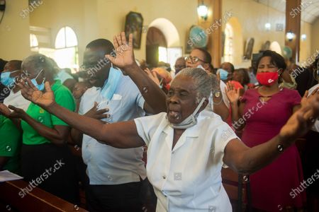 Parrishioners participate in a mass at the church of San Pedro at Petion-Ville, Port-au-Prince, Haiti, 15 April 2021. The bishops of Haiti celebrated a mass to protest against the abduction of twelve members of the clergy on 11 April. Since July 2018, Haiti has been mired in a strong protest movement demanding the resignation of President Jovenel Moise on allegations of not keeping his promises and profiting from corruption.