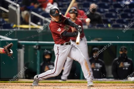 Arizona Diamondbacks' Andrew Young hits a grand slam during the second inning of the team's baseball game against the Washington Nationals at Nationals Park, in Washington