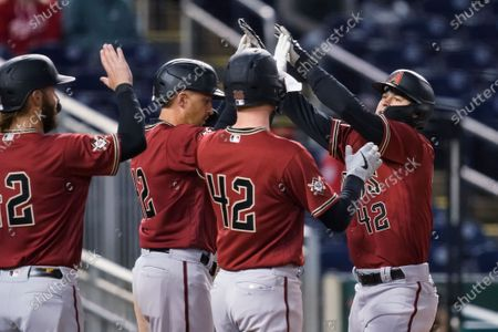 Arizona Diamondbacks' Andrew Young, right, celebrates his grand slam with his teammates during the second inning of a baseball game against the Washington Nationals at Nationals Park, in Washington