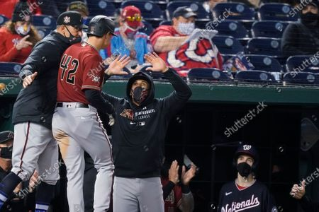 Stock Photo of Arizona Diamondbacks' Andrew Young, second from left, celebrates his grand slam with his teammates during the second inning of a baseball game against the Washington Nationals at Nationals Park, in Washington