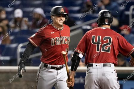 Stock Picture of Arizona Diamondbacks second baseman Andrew Young (L) celebrates after hitting a grand slam during the second inning of the Major League Baseball (MLB) game between the Arizona Diamondbacks and Washington Nationals at Nationals Park, in Washington, DC, USA, 15 April 2021. All players are wearing number 42 to honor Jackie Robinson Day, which is observed 15 April, to honor the day in 1947 that Jackie Robinson made his debut and became the first black major league baseball player of the modern era.