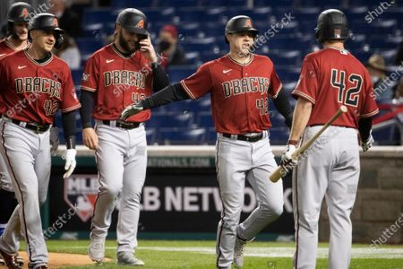 Arizona Diamondbacks second baseman Andrew Young (2-R) celebrates after hitting a grand slam during the second inning of the Major League Baseball (MLB) game between the Arizona Diamondbacks and Washington Nationals at Nationals Park, in Washington, DC, USA, 15 April 2021. All players are wearing number 42 to honor Jackie Robinson Day, which is observed 15 April, to honor the day in 1947 that Jackie Robinson made his debut and became the first black major league baseball player of the modern era.