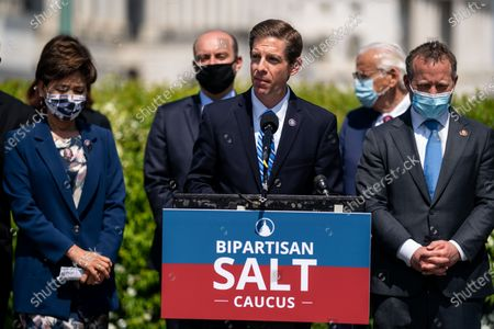 Rep. Mike Levin (D-CA), center, speaks while being flanked by Rep. Young Kim (R-CA) and Rep. Josh Gottheimer (D-NJ) at a news conference announcing the newly formed Bi-Partisan State and Local Taxes (SALT) Caucus outside the U.S. Capitol Building on Thursday, April 15, 2021 in Washington, DC. (Kent Nishimura / Los Angeles Times)