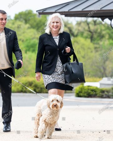 """U.S. Senator Kirsten Gillibrand (D-NY) seen with her dog """"Maple"""" at a press conference about the postal banking pilot program."""