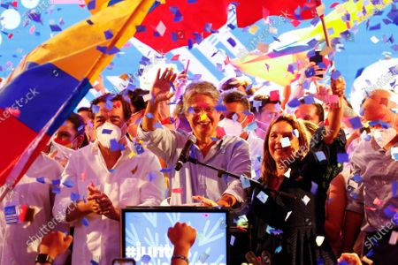Guillermo Lasso, presidential candidate of Creating Opportunities party, CREO, celebrates after a presidential runoff election at his campaign headquarters in Guayaquil, Ecuador, . With most of the votes counted Lasso, a former banker, had a lead over economist Andres Arauz, a protege of former President Rafael Correa