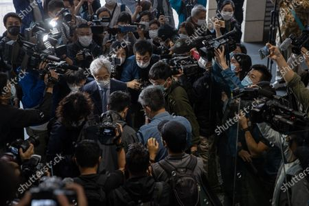 Former lawmaker Martin Lee Chu-Ming (L) arrives at the West Kowloon court building in Hong Kong, China, 16 April 2021. He is among nine democracy activists currently on trial and expected to be sentenced on 16 April for unauthorized assembly during a protest in 2019.