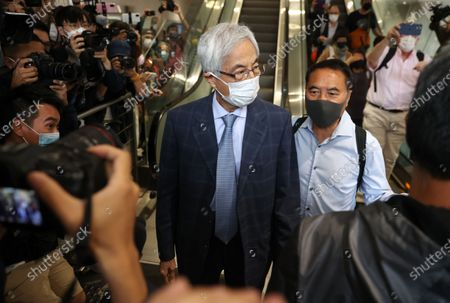 Former lawmaker Martin Lee Chu-Ming (C) is surrounded by members of the media after his sentencing at the West Kowloon court building in Hong Kong, China, 16 April 2021. Lee was given a suspended 11-month sentence for his role in an unauthorized assembly during anti-government protests in 2019. He is among nine democracy activists that were on trial and sentenced on 16 April.