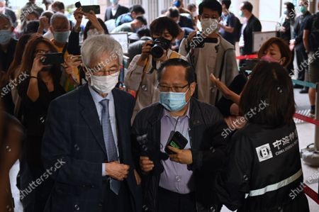 Pro-Democracy activist (L) Martin Lee (R) Albert Ho, arrive at West Kowloon  Magistrates Court, to appear at a court for sentencing in Hong Kong, Friday, April 16, 2021. They are here in court to receive sentencing after being found guilty of organizing an unauthorised assembly on August 18, 2019.