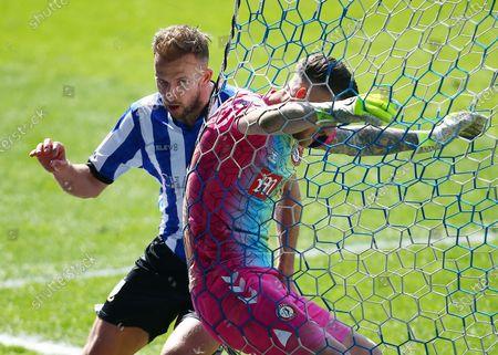 Jordan Rhodes of Sheffield Wednesday and Bristol City goalkeeper Daniel Bentley