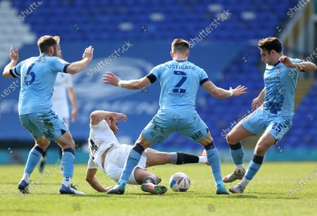Barnsley's Carlton Morris is surrounded by Matty James, Liam Kelly and Leo Skiri Ostigard of Coventry City