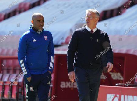 Charlton manager Nigel Adkins talks with Ipswich assistant coach Kieron Dyer