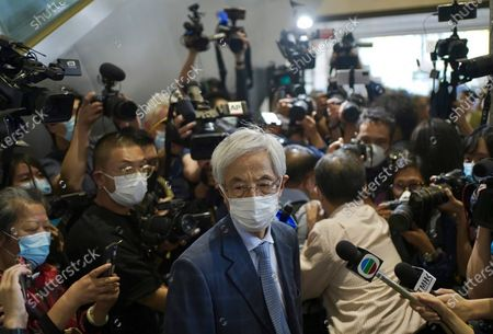Martin Lee, center, 82-year-old lawyer and former lawmaker, leaves a court after his jail sentences suspended in Hong Kong . A Hong Kong court on Friday sentenced five leading pro-democracy advocates, including media tycoon Jimmy Lai, to up to 18 months in prison for organizing a march during the 2019 anti-government protests that triggered an overwhelming crackdown from Beijing