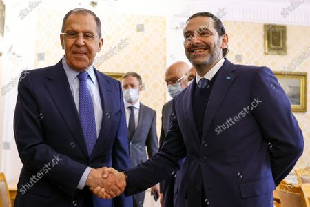 In this handout photo released by Russian Foreign Ministry Press Service, Russian Foreign Minister Sergey Lavrov, left, and Lebanese Prime Minister Saad Hariri pose for a photo prior to their talks in Moscow, Russia