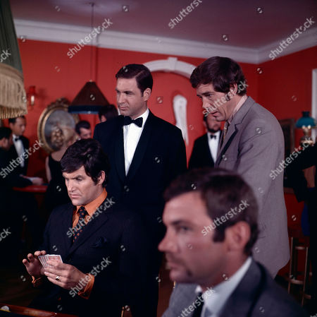 Paul Lang, as played by Edward Brayshaw, Alan Corder, as played by Paul Maxwell, and Jeff Randall, as played by Mike Pratt, with poker players