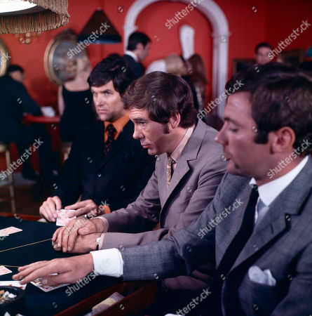 Paul Lang, as played by Edward Brayshaw, and Jeff Randall, as played by Mike Pratt, with poker players