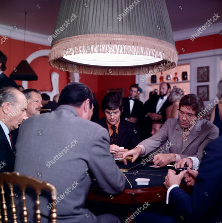 1st Poker Player, as played by Arnold Diamond, 2nd Poker Player, as played by Neal Arden, Paul Lang, as played by Edward Brayshaw, and Jeff Randall, as played by Mike Pratt, with poker players