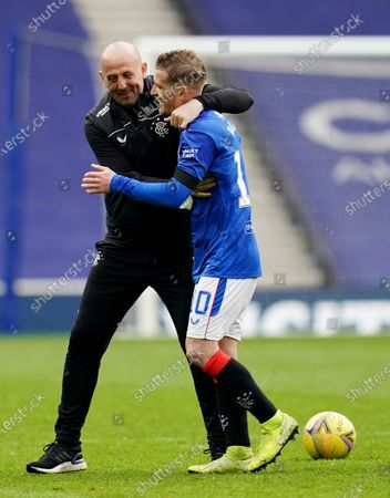 Rangers Assistant Manager Gary McAllister celebrates with Steven Davis of Rangers.