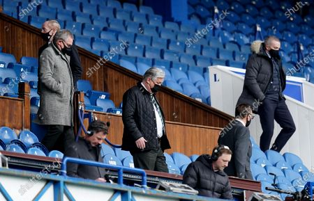 Celtic Chief Executive Peter Lawwell leaves the directors box with Club Director Brian Wilson.