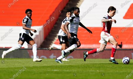 Stock Picture of Andre Frank Zambo Anguissa of Fulham chases Hector Bellerin of Arsenal