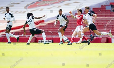 Stock Photo of Hector Bellerin of Arsenal watched by four Fulham players