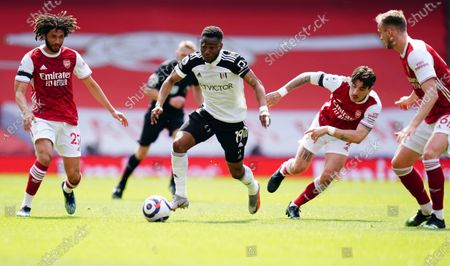 Stock Image of Ademola Lookman of Fulham in between Mohamed Elneny and Hector Bellerin of Arsenal
