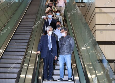 Former lawmaker Martin Lee Chu-Ming (front L) rides an escalator after his sentencing at the West Kowloon court building in Hong Kong, China, 16 April 2021. Lee was given a suspended 11-month sentence for his role in an unauthorized assembly during anti-government protests in 2019. He is among nine democracy activists that were on trial and sentenced on 16 April.