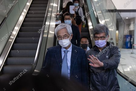 Martin Lee Chu-Ming (L) leaves the West Kowloon court buildings in Hong Kong, China, 16 April 2021. Lee was given a suspended 11-month sentence for his role in an unauthorized assembly during anti-government protests in 2019. He is among nine democracy activists that were on trial and sentenced on 16 April.