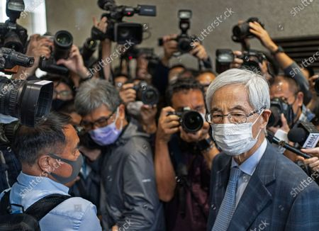 Martin Lee, 82-year-old lawyer and former lawmaker, right, leaves a court after receiving a suspended sentence in Hong Kong . A Hong Kong court on Friday sentenced five leading pro-democracy advocates, including media tycoon Jimmy Lai, to up to 18 months in prison for organizing a march during the 2019 anti-government protests that triggered an overwhelming crackdown from Beijing