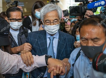 Pro-democracy activist Martin Lee walks out from a court after receiving a suspended sentence in Hong Kong . A Hong Kong court on Friday sentenced five leading pro-democracy advocates, including media tycoon Jimmy Lai, to up to 18 months in prison for organizing a march during the 2019 anti-government protests that triggered an overwhelming crackdown from Beijing
