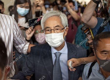 Pro-democracy activist Martin Lee walks out from a court after receiving a suspended sentence in Hong Kong . A Hong Kong court on Friday sentenced five leading pro-democracy advocates, including media tycoon Jimmy Lai, to up to 18 months in prison for organizing a march during the 2019 anti-government protests that triggered an overwhelming crackdown from Beijing. A total of nine advocates were given jail terms, but four of them, including 82-year-old lawyer and former lawmaker Martin Lee, had their sentences suspended after their age and accomplishments were taken into consideration