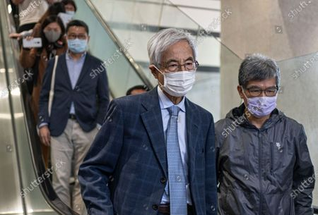 Stock Image of Pro-democracy activist Martin Lee, center, walks out from a court after receiving a suspended sentence in Hong Kong, . A Hong Kong court on Friday sentenced five leading pro-democracy advocates, including media tycoon Jimmy Lai, to up to 18 months in prison for organizing a march during the 2019 anti-government protests that triggered an overwhelming crackdown from Beijing. A total of nine advocates were given jail terms, but four of them, including Lee, had their sentences suspended after their age and accomplishments were taken into consideration