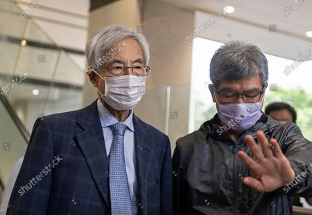 Pro-democracy activist Martin Lee, left,walks out from a court after receiving a suspended sentence in Hong Kong, . A Hong Kong court on Friday sentenced five leading pro-democracy advocates, including media tycoon Jimmy Lai, to up to 18 months in prison for organizing a march during the 2019 anti-government protests that triggered an overwhelming crackdown from Beijing. A total of nine advocates were given jail terms, but four of them, including Lee, had their sentences suspended after their age and accomplishments were taken into consideration