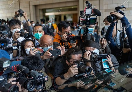 Stock Picture of Photographers take pictures of pro-democracy activist Martin Lee leaving a court in Hong Kong . A Hong Kong court on Friday sentenced five leading pro-democracy advocates, including media tycoon Jimmy Lai, to up to 18 months in prison for organizing a march during the 2019 anti-government protests that triggered an overwhelming crackdown from Beijing. A total of nine advocates were given jail terms, but four of them, including 82 year old Lee, had their sentences suspended after their age and accomplishments were taken into consideration